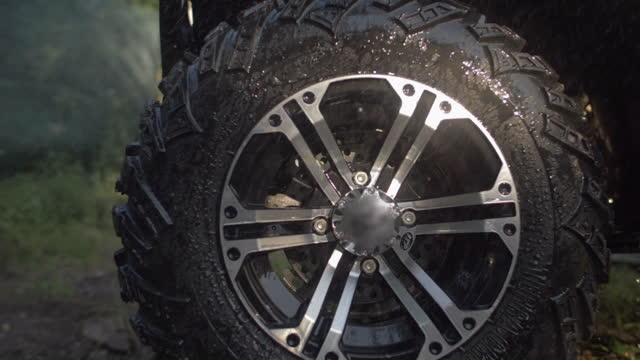 washing atv quad motocross motorcycles vehicles on a dirt off road. - slow motion - wheel stock videos & royalty-free footage