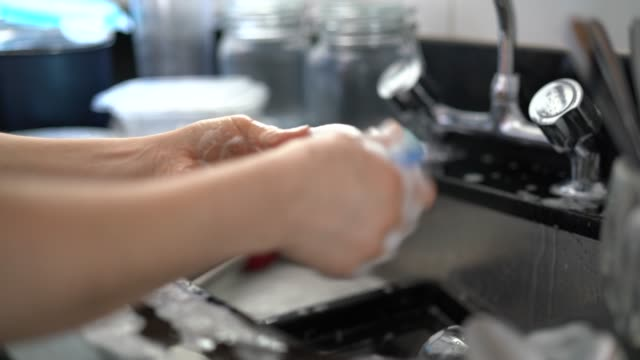 washing dishes - utensil stock videos & royalty-free footage