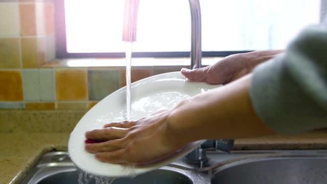 washing dishes - scrubs stock videos & royalty-free footage