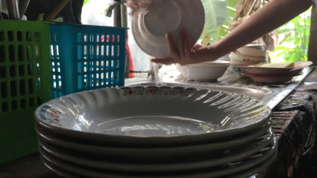 washing dishes - washing up stock videos and b-roll footage