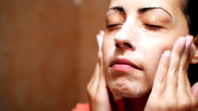 washing face in the morning - body care stock videos & royalty-free footage
