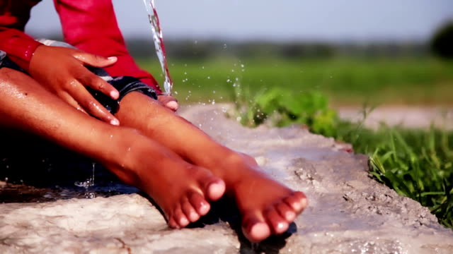 washing feet outdoor in nature - hamlet play stock videos and b-roll footage