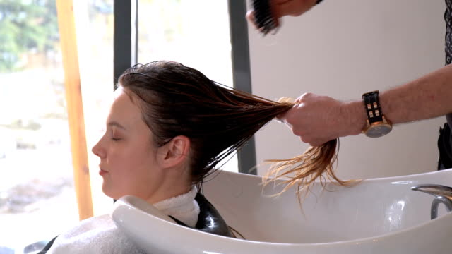 washing hair by hairdresser - washing hair stock videos & royalty-free footage