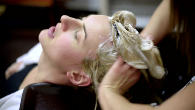 washing hair - beauty salon stock videos and b-roll footage