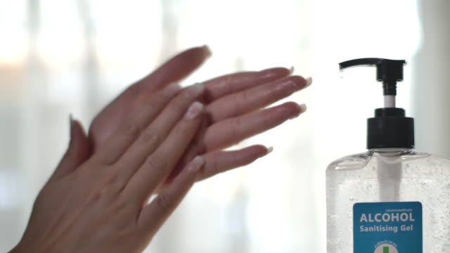 washing hand with alcohol gel,slow motion - rubbing alcohol stock videos & royalty-free footage