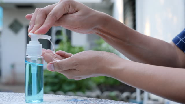 washing hand with alcohol slow motion - soap dispenser stock videos & royalty-free footage