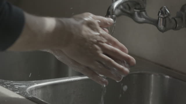 washing hands at kitchen sink - housework stock videos & royalty-free footage