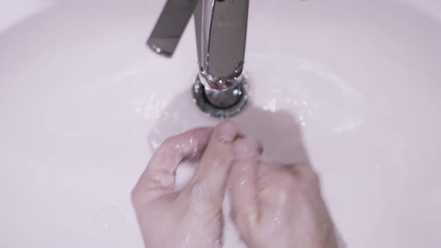 washing hands in a bathroom sink - bar of soap stock videos & royalty-free footage