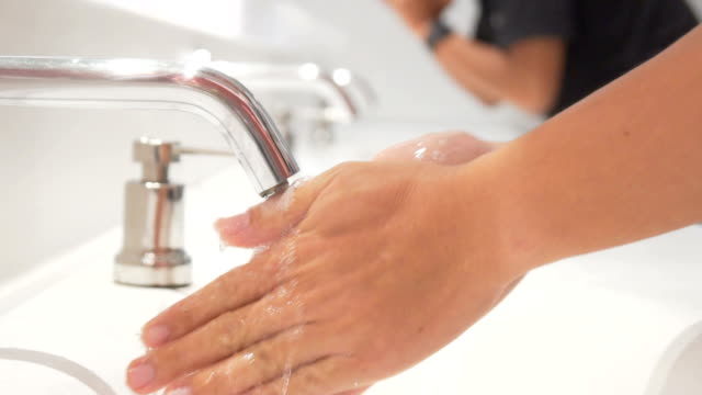 Washing hands under running water,Slow motion