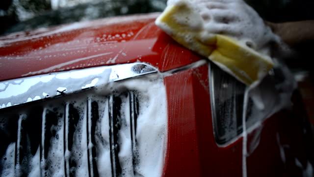 washing headlight - biltvätt bildbanksvideor och videomaterial från bakom kulisserna