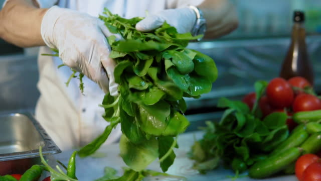 washing lettuce leaves - moving down stock videos & royalty-free footage