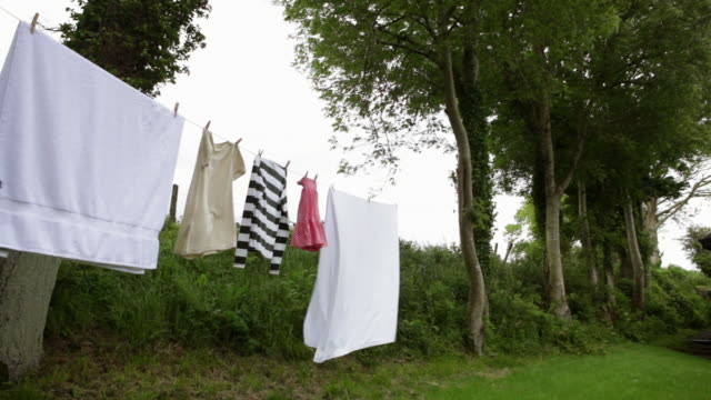 stockvideo's en b-roll-footage met washing line of laundry - wasknijper