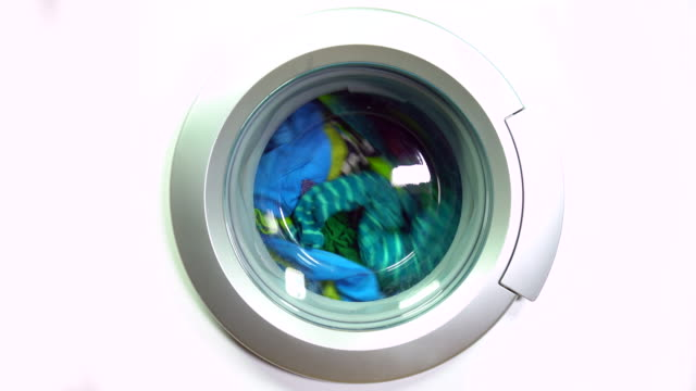 washing machine and colorful laundry - multi coloured stock videos & royalty-free footage