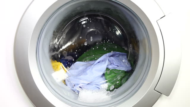 washing machine and colorful laundry - soap sud stock videos & royalty-free footage