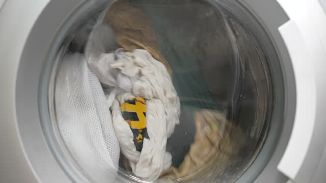 washing machine, washing clothes process in slow motion - laundry detergent stock videos & royalty-free footage