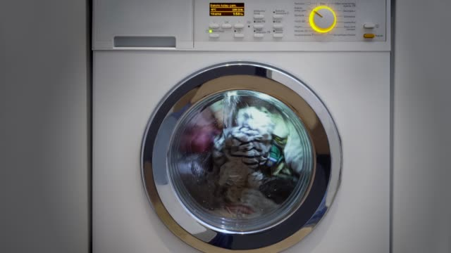 washing machine with laundry - launderette stock videos & royalty-free footage