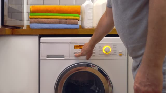 washing machine with laundry - laundry stock videos & royalty-free footage