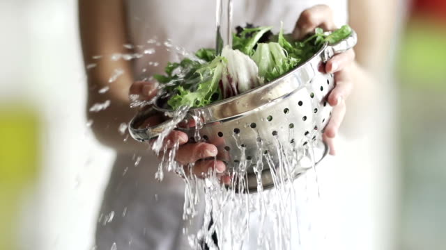 washing salad     fo  he - vegetable stock videos & royalty-free footage