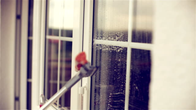 washing the window - window washer stock videos & royalty-free footage