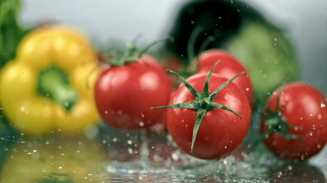 slo mo washing tomatoes - super slow motion stock videos & royalty-free footage