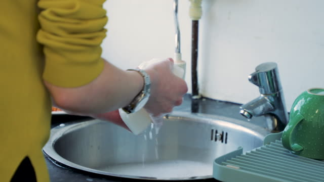 washing up - washing up stock videos and b-roll footage