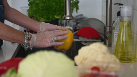 washing vegetable with gloves on - prevention stock videos & royalty-free footage