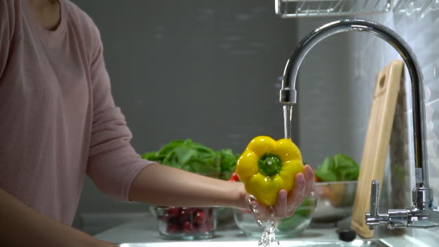 washing yellow bell pepper - washing stock videos & royalty-free footage