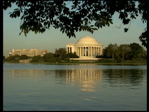 buildings and monuments i various of jefferson memorial and washington memorial seen from across tidal basin including shots of reflections on... - jefferson memorial stock videos and b-roll footage