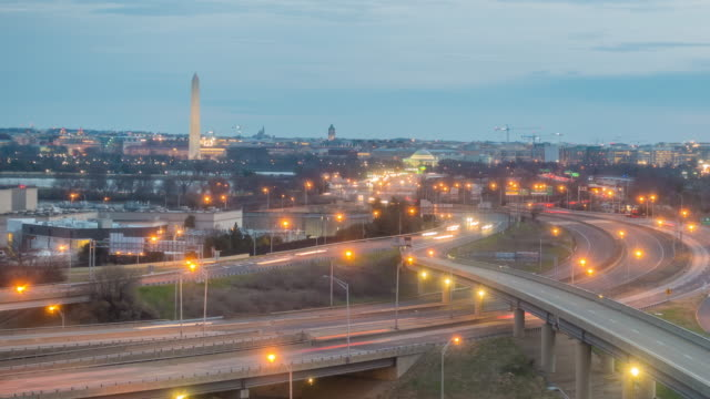 washington, d.c. city skyline at twilight - autostrada interstatale americana video stock e b–roll
