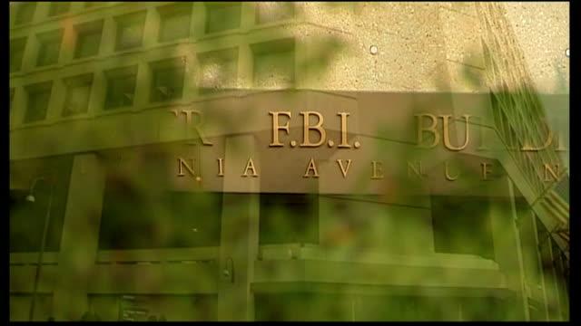 washington dc ext leaves pull focus fbi sign on building exterior of j edgar hoover building fbi police vehicle - fbi stock videos & royalty-free footage