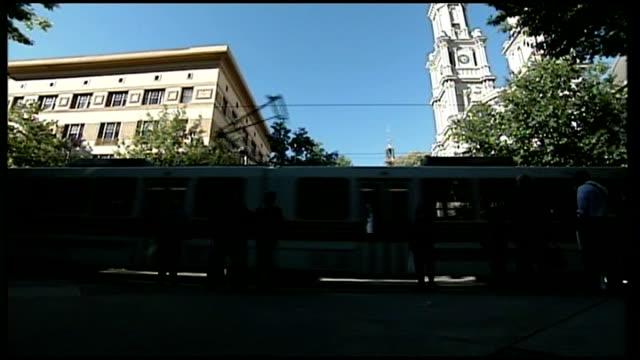 EXT Streetcar along Reporter to camera