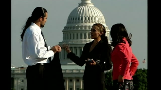 washington dc ext various of ahmad batebi standing with reporter and his lawyer with united states capitol in background - united states congress点の映像素材/bロール