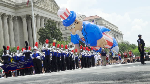 national independence day parade via constitution avenue along the national mall from 7th to 17th street - uncle sam stock videos & royalty-free footage