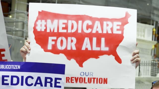 Activist from the Center for Popular Democracy CPD Action rallied in Washington DC during the universal health care hearing on June 12 2019 During a...