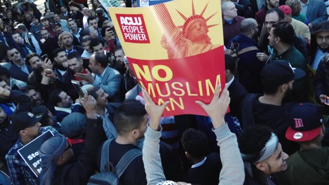 Activist and supporters protest President Donald Trump's third travel ban proposal which restricts entry into the United States from Muslimmajority...
