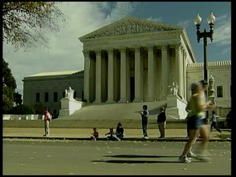 runners along past us supreme court marathon competitors running along gv supreme court building clean feed tape = d0509493 or d0509494 00014600... - us supreme court building stock videos and b-roll footage