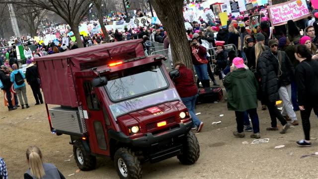 washington dc united states – january 21 2017 hundreds of thousands of people took part in the women's march in washington on jan 21 to protest us... - emergency services vehicle stock videos and b-roll footage