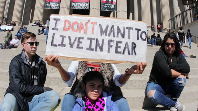 """washington, d.c., usa: a woman holds a sign reading, """"i don't want to live in fear."""" protesters participate in the march for our lives rally on march... - 2018 stock videos & royalty-free footage"""