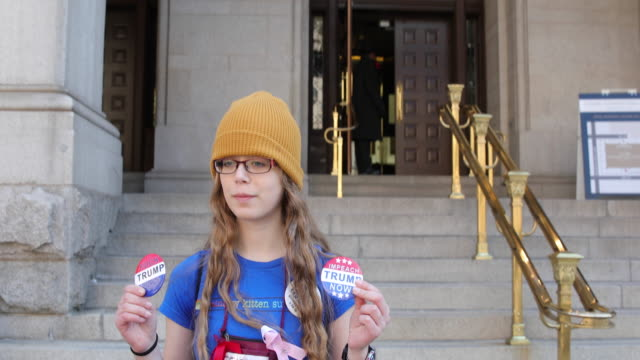 teen age girl holding anti trump pins near the trump international hotel during the march for our lives rally on march 24 2018 in washington dc more... - march for our lives stock videos and b-roll footage