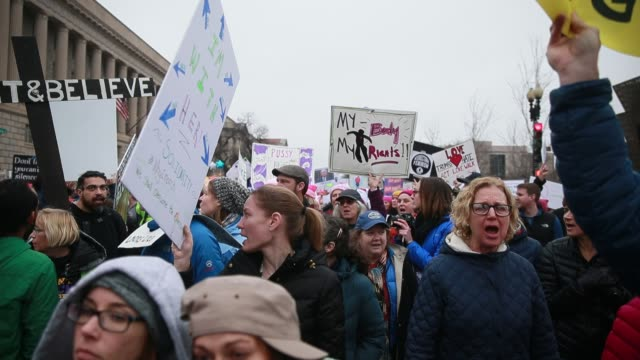 Women march along Constitution Avenue during the Women's March on Washington More than 500000 Women's March participants marched in the streets of...