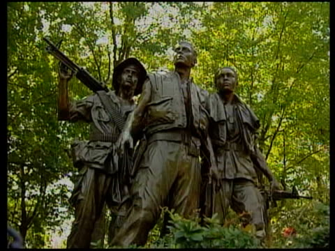 war memorials; good general views of three soldiers statue in the summer / floral wreath tribute / people along vietnam memorial wall on sunny day - sunny video stock e b–roll