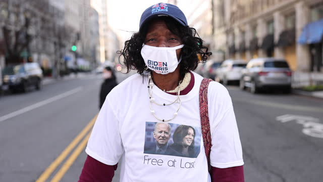 washington, district of columbia, usa: ella smith wears a t-shirt in celebration the day joe biden is inaugurated as president of the united states... - portrait stock videos & royalty-free footage