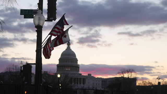 washington, district of columbia, usa: flags line pennsylvania avenue looking toward the united states capitol three days after the inauguration of... - president stock videos & royalty-free footage