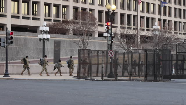 vídeos de stock, filmes e b-roll de washington, district of columbia, usa: national guard troops leave walk past the department of labor near the united states capitol building three... - cerca