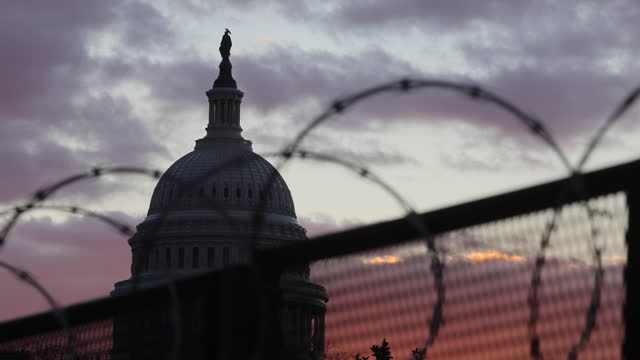 washington, district of columbia, usa: the united states capitol building is surrounded by a security fence three days after the inauguration of... - fence stock videos & royalty-free footage