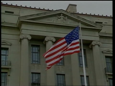 washington; ext gv us justice department with us national flag flying outside zoom in - timothy mcveigh stock videos & royalty-free footage