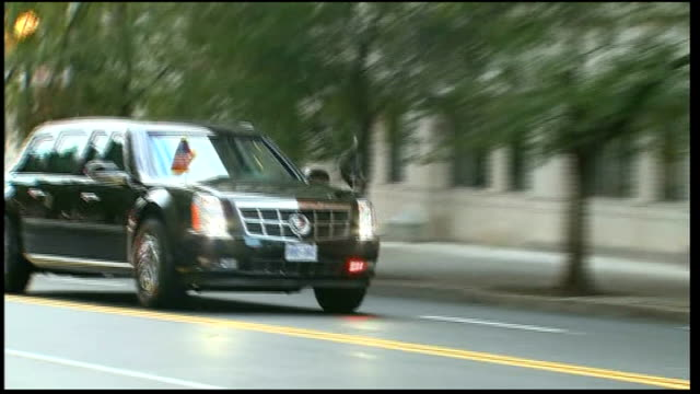 washington overlay 'the daily show'** barack obama limousine along road - limousine stock-videos und b-roll-filmmaterial