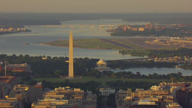 WS AERIAL POV Washington Monument and Jefferson Memorial at Tidal Basin with Washington Reagan National Airport / Washington DC, United States