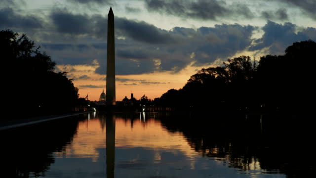 washington monument and lincoln memorial reflecting pool, washington d.c, usa at dawn - washington monument washington dc stock videos & royalty-free footage