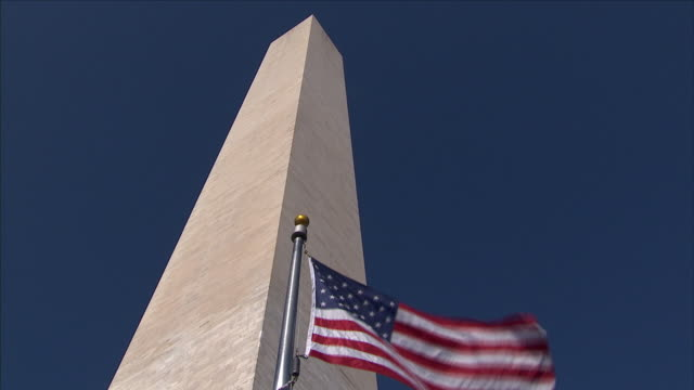 Washington Monument and the flag of the United States of America